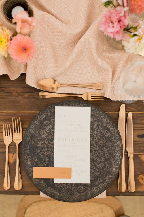 Black Tableware and Gold Cutlery Place Setting