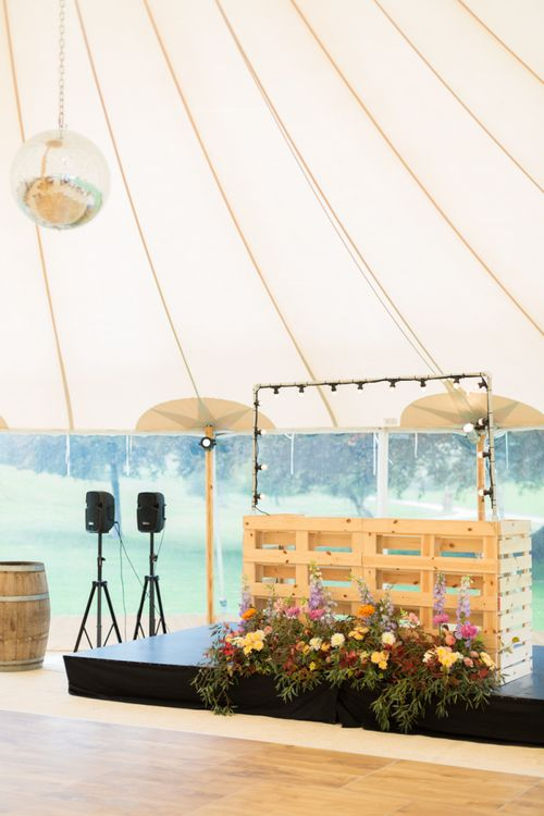 Wooden DJ Booth with Colourful Wedding Flowers