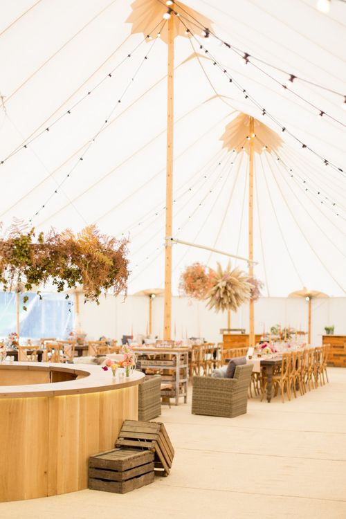 Papakata Sperry Tent Reception with Wooden Bar, Festoon Lights, and Wooden Reception Tables