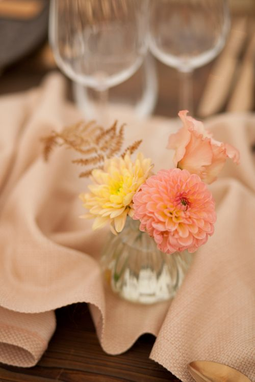 Pink and Yellow Dahlia Flower Heads in Small Vase