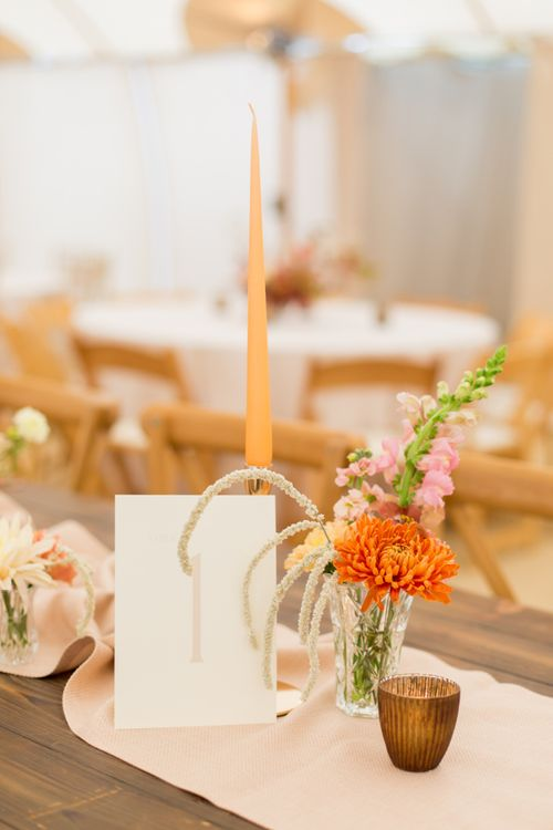 Table Number Card with Taper Candles and Small Flower Arrangement in a Vase