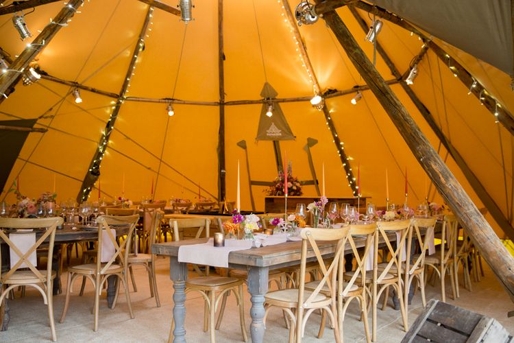 PapaKata Tipi Wedding Reception with Wooden Tables and Fairy Lights