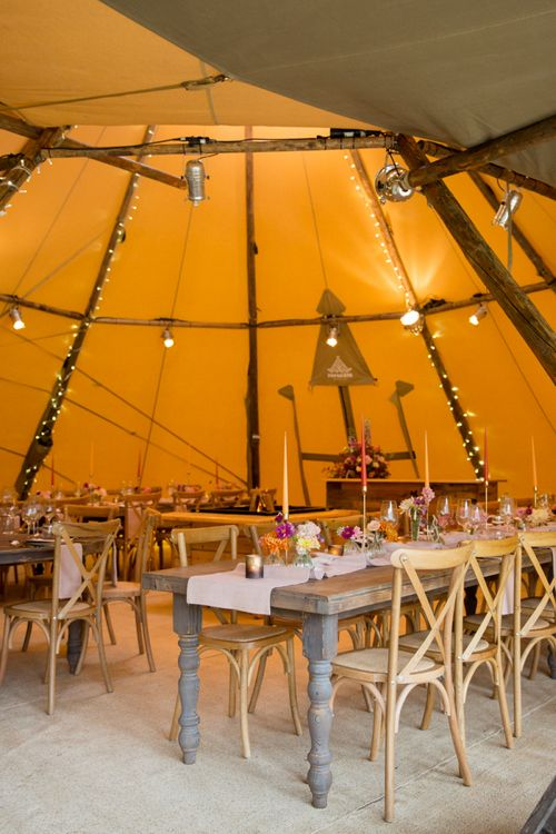 PapaKata Teepee Wedding Reception with Wooden Tables and Fairy Lights