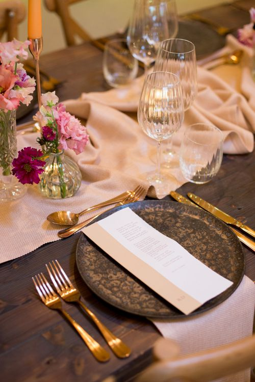 Place Setting with Black Charger Plate and Gold Cutlery