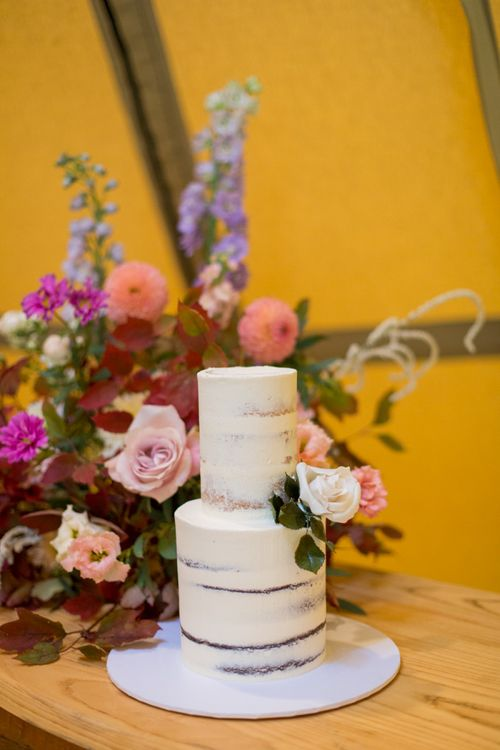 Semi Naked Wedding Cake with Colourful Floral Arrangement