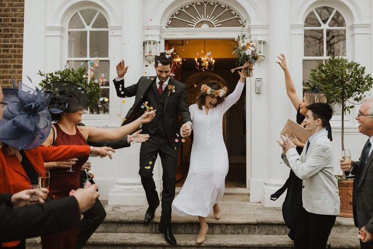 Couple say 'I do' at Linden House wedding with modern style boho decor