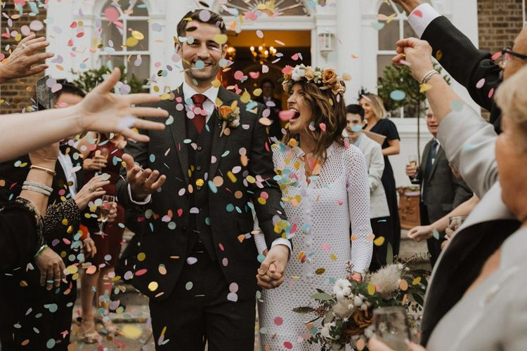 Confetti shot at Linden House intimate ceremony with bride wearing beautiful flower crown and vintage dress