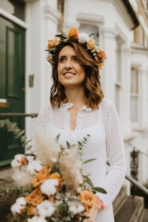 Bride wearing  roses and cotton flower floral crown teamed with vintage dress