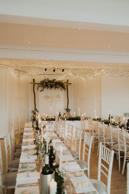 Festoon lighting and floral decor for a relaxed reception dinner at Linden House