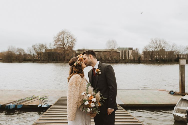 Hammersmith riverside winter wedding at Linden House in London with modern boho flowers and vintage dress
