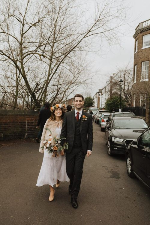 Winter wedding at Linden House in London with bride wearing beautiful floral crown and Groom in three piece suit