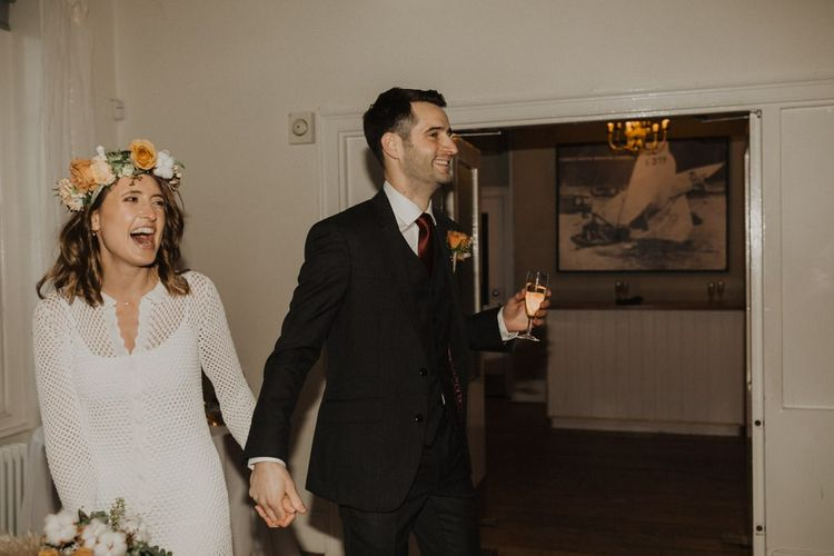 Bride and groom at Linden House for intimate wedding with modern boho styling  and floral crown