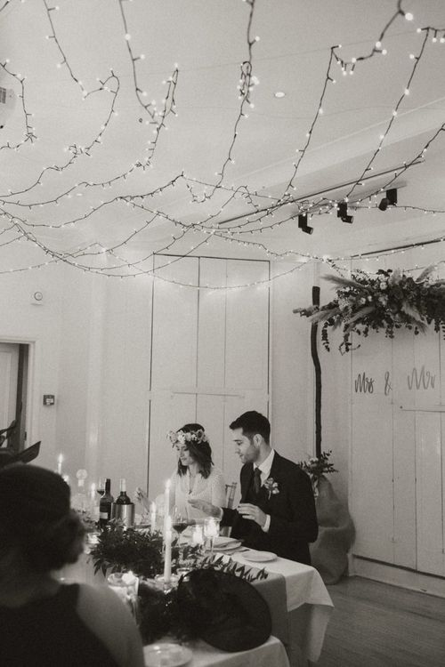 Bride and groom at Linden House for a relaxed boho wedding with festoon lighting