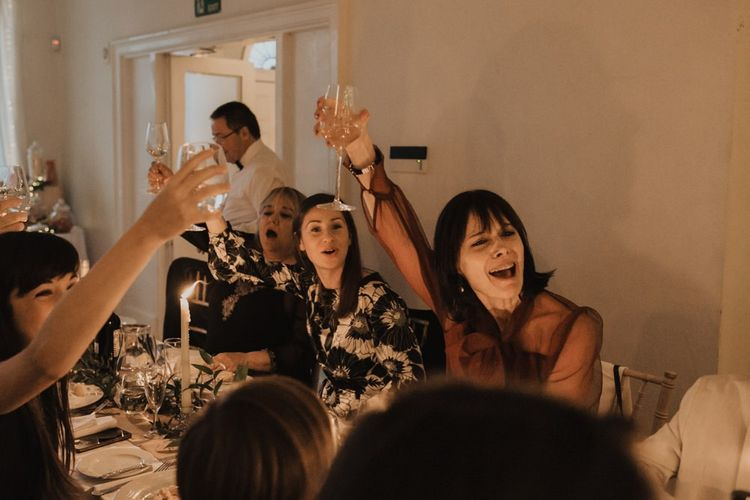 Guests celebrating at Linden House for a intimate and relaxed dinner reception