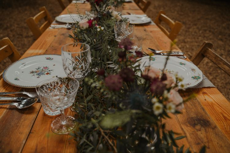 Rustic Tablescape with Floral Runner and Vintage Tableware