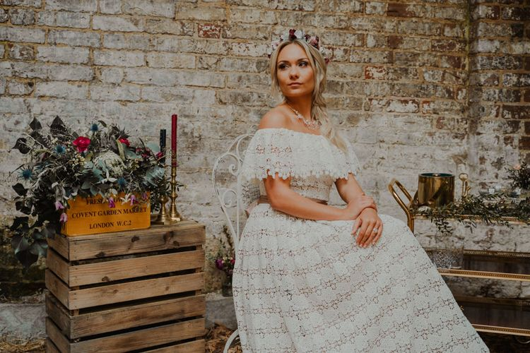 Boho Bride in Bardot Lace Wedding Dress with Crate Wedding Decor