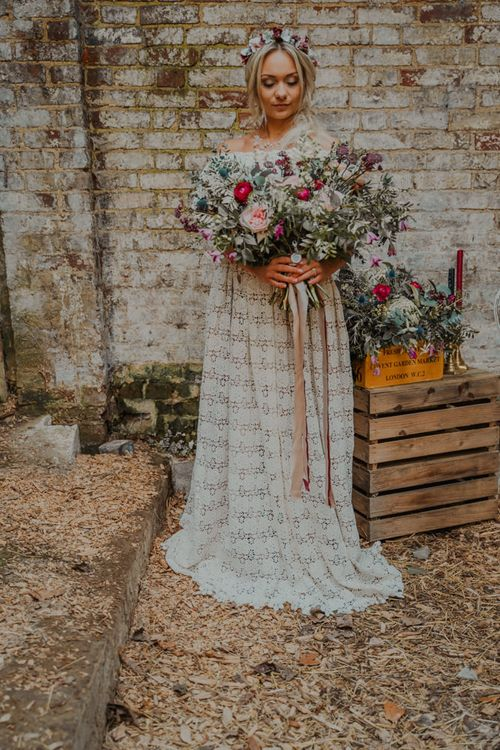 Boho Bride in Lace Wedding Dress with Romantic Pink & Red Oversized Wedding Bouquet