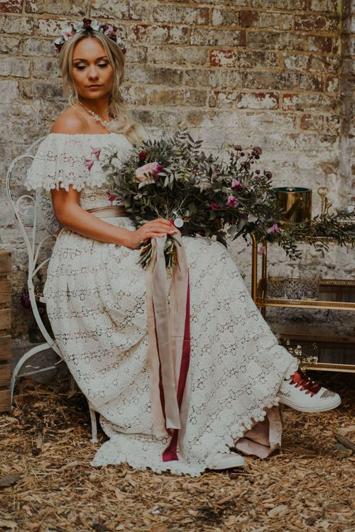 Bohemian Bride in Lace Wedding Dress and Customised Converse Trainers