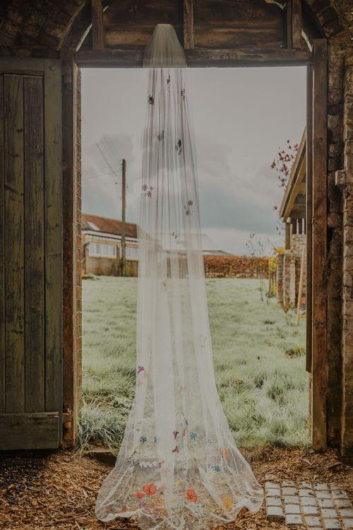 Floral Anne-Marie Prescott Handmade Wedding Veil in Barn Doorway
