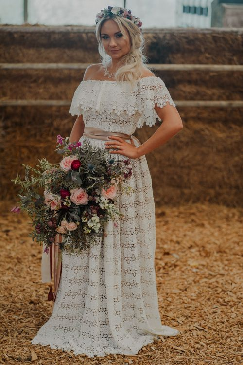 Bride in Lace Wedding Dress with Romantic Bridal Bouquet