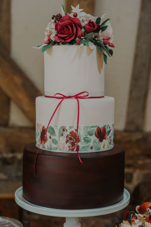 Three Tier Wedding Cake with Chocolate Layer , Painted Flower Trim and  Floral Cake Topper