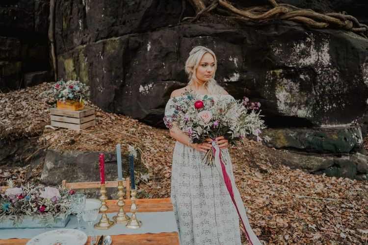 Bohemian Bride Standing at her Rustic Tablescape