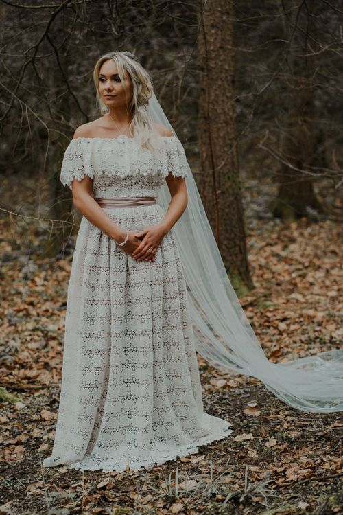 Bride in Lace Wedding Dress with Pink Ribbon Belt