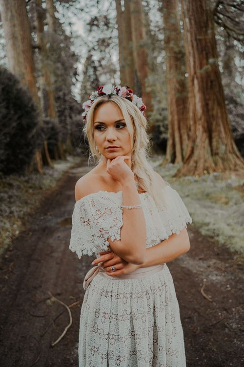 Boho Bride Standing in the Forest in a Lace Wedding Dress