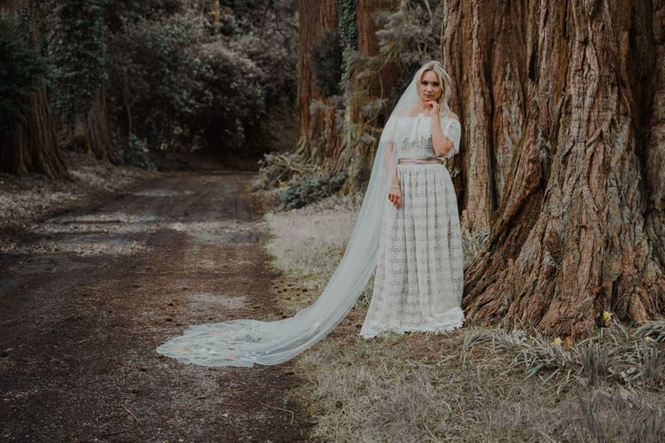 Beautiful Bride Portrait in the Woodland Showing of her Lace Wedding Dress and Veil