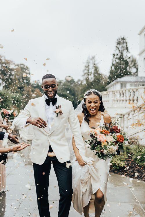 Confetti moment at Coworth Park black tie wedding