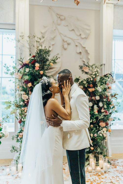 You may now kiss the bride moment at Coworth Park by Rebecca Carpenter Photography