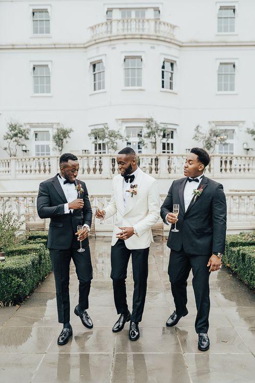 Groomsmen in tuxedos at Coworth Park wedding