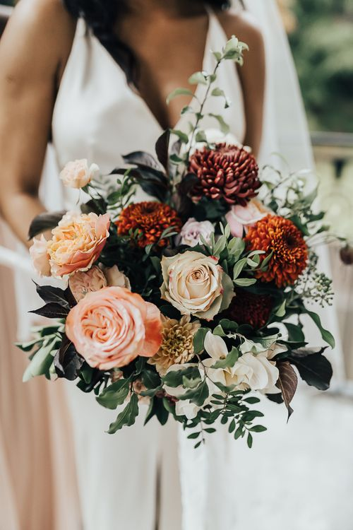 Autumn bridal bouquet with pinks, orange and green wedding flowers