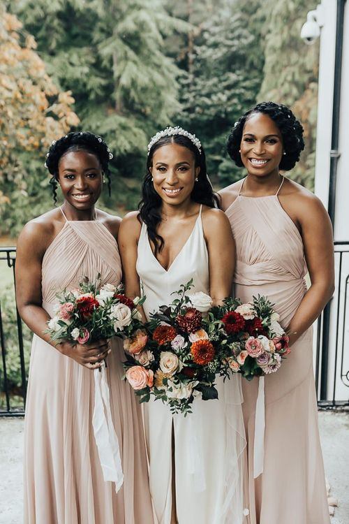 Bridesmaid picture with bridesmaids in pink dresses at Coworth Park
