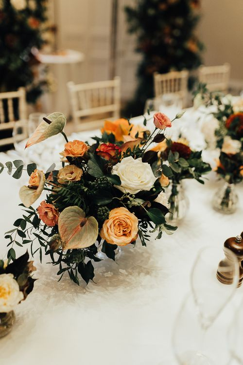 Autumn wedding flowers with roses, anthuriums and foliage