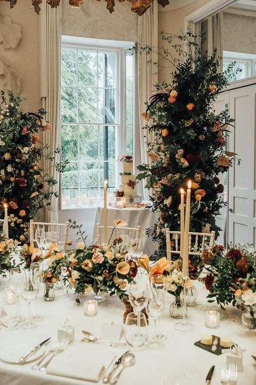 Intimate wedding reception with autumn flowers and candlelight