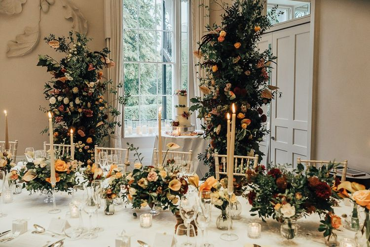 Wedding reception table flowers and decor at Coworth Park