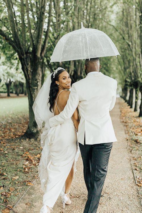 Stylish bride and groom at black tie wedding