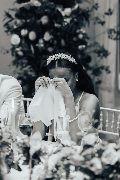 Emotional bride during wedding reception speeches