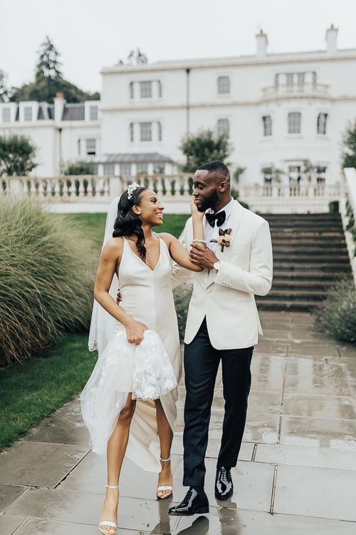 Stylish bride and groom portrait by Rebecca Carpenter Photography at Coworth Park