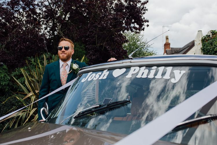 Groom in Paul Smith Suit | Outdoor Wedding Ceremony & Tipi Reception Planned by Benessamy Events | Red on Blonde Photography