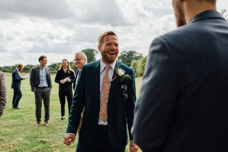 Bride in Paul Smith Suit | Outdoor Wedding Ceremony & Tipi Reception Planned by Benessamy Events | Red on Blonde Photography
