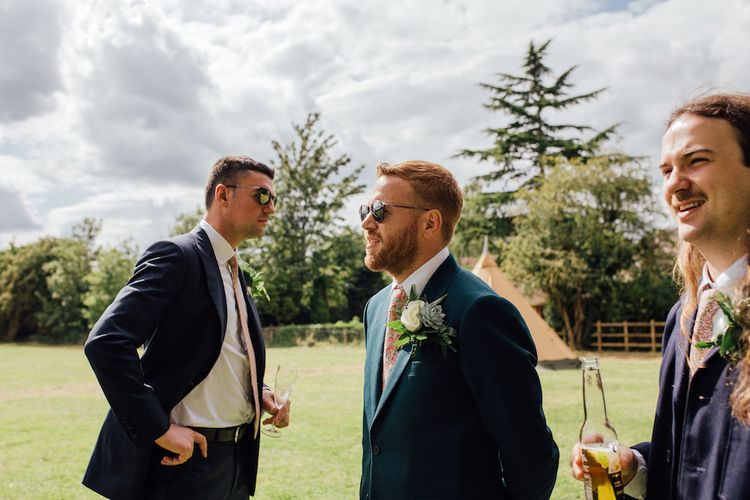 Groom in Paul Smith Suit & Liberty Print Tie | Outdoor Wedding Ceremony & Tipi Reception Planned by Benessamy Events | Red on Blonde Photography