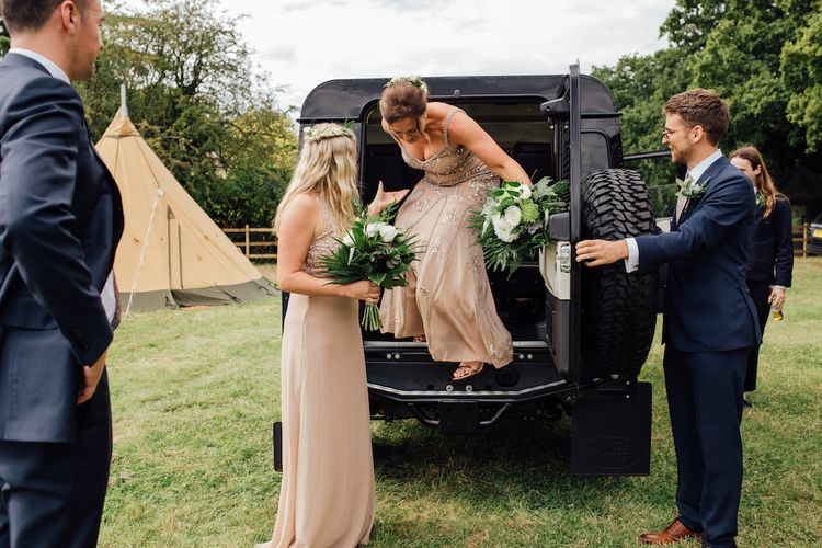 Bridesmaid Entrance in Sequin Dresses | Outdoor Wedding Ceremony & Tipi Reception Planned by Benessamy Events | Red on Blonde Photography