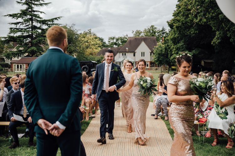 Wedding Ceremony | Bridesmaid Entrance in Sequin Dresses | Outdoor Wedding Ceremony & Tipi Reception Planned by Benessamy Events | Red on Blonde Photography