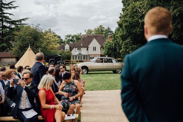 Vintage Citroen DS Wedding Car | Outdoor Wedding Ceremony & Tipi Reception Planned by Benessamy Events | Red on Blonde Photography