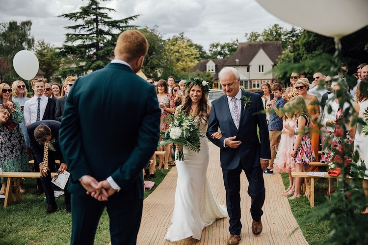 Wedding Ceremony | Bridal Entrance in La Sposa Gown from Mirror Mirror Bridal | Groom in Paul Smith Suit | Outdoor Wedding Ceremony & Tipi Reception Planned by Benessamy Events | Red on Blonde Photography