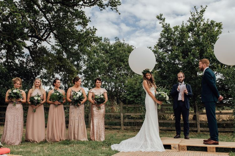 Bridesmaids in Blush Sequin Dresses | Bride in La Sposa Gown from Mirror Mirror Bridal | Groom in Paul Smith Suit | Outdoor Wedding Ceremony & Tipi Reception Planned by Benessamy Events | Red on Blonde Photography