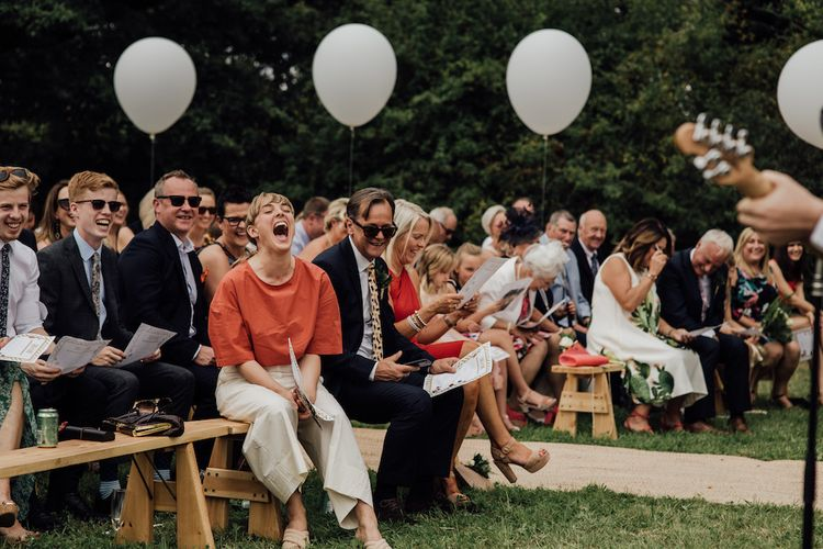 Wedding Ceremony | Giant Balloon Decor | Outdoor Wedding Ceremony & Tipi Reception Planned by Benessamy Events | Red on Blonde Photography