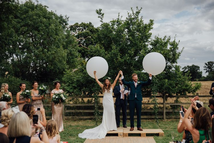 Wedding Ceremony | Giant Balloon Decor | Bride in La Sposa Gown from Mirror Mirror Bridal | Groom in Paul Smith Suit | Outdoor Wedding Ceremony & Tipi Reception Planned by Benessamy Events | Red on Blonde Photography